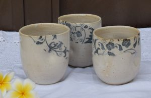 three flowers decorated ceramic cups