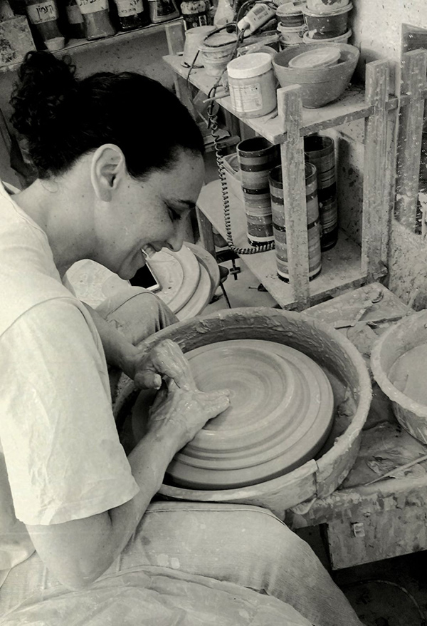 Ayelet working on the potter's wheel